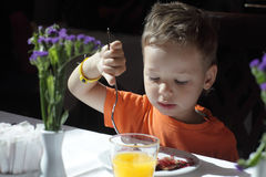 Child has breakfast Royalty Free Stock Photos
