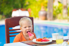 Child has a breakfast Royalty Free Stock Photos