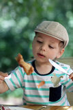 Child has chicken Royalty Free Stock Images