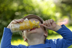 Child has corn Royalty Free Stock Photography