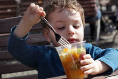 Child has fruits Stock Photo