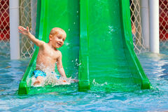 Child has a fun in aqua park swimming pool Stock Image