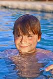 Child has fun in the outdoor pool Stock Image
