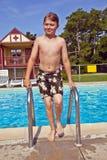 Child has fun in the pool Stock Photo