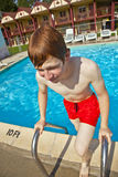 Child has fun in the pool Royalty Free Stock Images