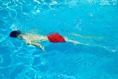Child has fun in the pool Stock Photos