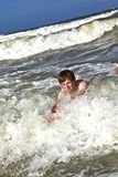Child has fun in the waves Royalty Free Stock Photography