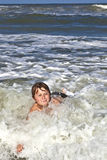 Child has fun in the waves Stock Photos