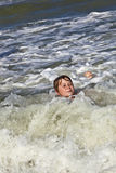 Child has fun in the waves Stock Photo