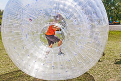 Child has fun in the Zorbing Ball Stock Image