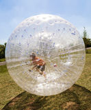 Child has fun in the Zorbing Ball Royalty Free Stock Photography