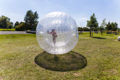 Child has fun in the Zorbing Ball Royalty Free Stock Images