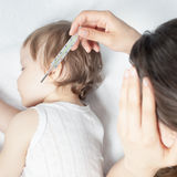 Child has a high temperature or fever, using a thermometer