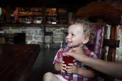 Child has juice Royalty Free Stock Photo