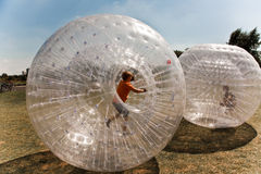Child has a lot of fun. Children have a lot of fun in the Zorbing Ball Royalty Free Stock Photography