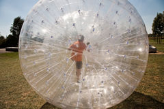 Child has a lot of fun in the Zorbing Ball Royalty Free Stock Image