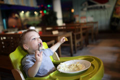 Child has a lunch Royalty Free Stock Photography