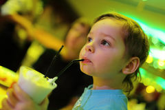 Child has milk shake Royalty Free Stock Images
