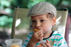Child has peach Stock Photography