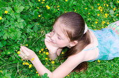 The child has a rest on a glade with flowers Stock Photography