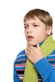 The child has a sore throat. He tied a warm scarf Royalty Free Stock Photo