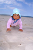 Child in hat. Baby smile and crawl on the beach royalty free stock photos