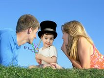 Child in hat with parents on grass, collage Royalty Free Stock Photography