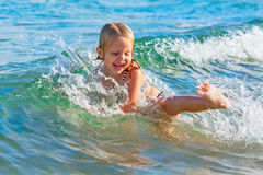 Child have a fun in breaking beach waves Royalty Free Stock Image