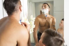 Child Have Fun With Dad Shaving Foam In The Bathroom Royalty Free Stock Photography