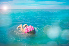 Child have somersault in the water Royalty Free Stock Photography