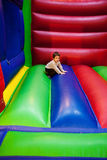 Child having a break in playground Stock Images