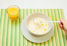 Child having cereals for breakfast Royalty Free Stock Photography