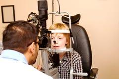 Child having eye examination with Slit Lamp Stock Photo