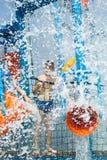 Child  having fun in aqua park Royalty Free Stock Images