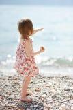 A child having fun on a beach Stock Photos