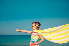 Child having fun on the beach Royalty Free Stock Photo