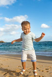 Child having fun on the beach Royalty Free Stock Images