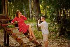 Child having fun, blowing dandelions. Childhood happiness concept, boy playing with dandelions stock images