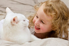 Child having fun with cat Royalty Free Stock Photos