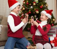 Child having fun in christmas decoration at home, happy emotion, winter holiday concept Stock Photos