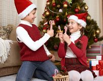 Child having fun in christmas decoration at home, happy emotion, winter holiday concept Royalty Free Stock Photo