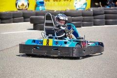 Child having fun on a go cart. Summer season Royalty Free Stock Photo