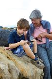 Child having fun with grandmother with tablet outdoors Royalty Free Stock Photography