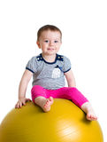 Child having fun with  gymnastic ball isolated Stock Photos