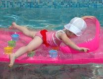 Child having fun an inflatable mattress Stock Photos