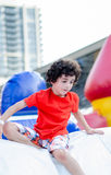 Child having fun in an outdoors park during summer Royalty Free Stock Images
