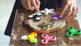 Child having fun outdoors with Spinner, slow motion. Young caucasian girl showing skills by flicking spinners with stock video