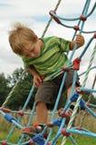 Child having fun on playground Royalty Free Stock Image