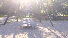 Children riding on zip line. Child having fun is riding zipline. Cute girl moving on zip line at playground - outdoors stock video footage