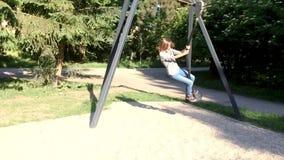 Children riding on zip line. Child having fun is riding zipline. Cute girl moving on zip line at playground - outdoors stock footage